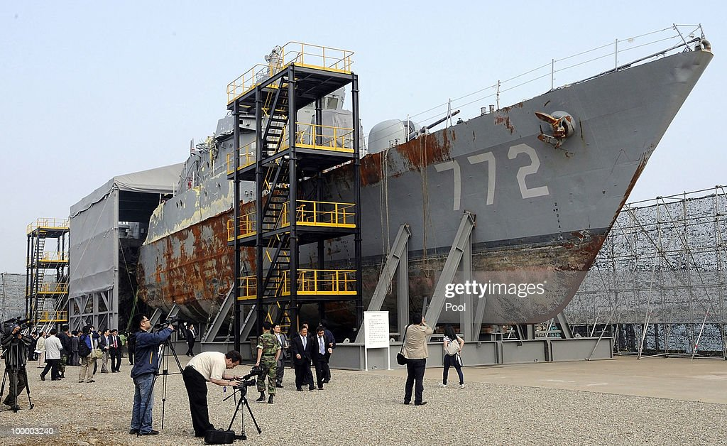South Korean Navy rear admiral Park Jung-Soo talks in front of the wreckage of the naval vessel Cheonan, which was sunk on March 26 near the maritime border with North Korea, at the Second Fleet Command's naval base on May 20, 2010 in Pyeongtaek, South Korea. The multinational investigation team concluded that North Korea's torpedo sank the South Korean warship on March 26, killing 46 sailors.