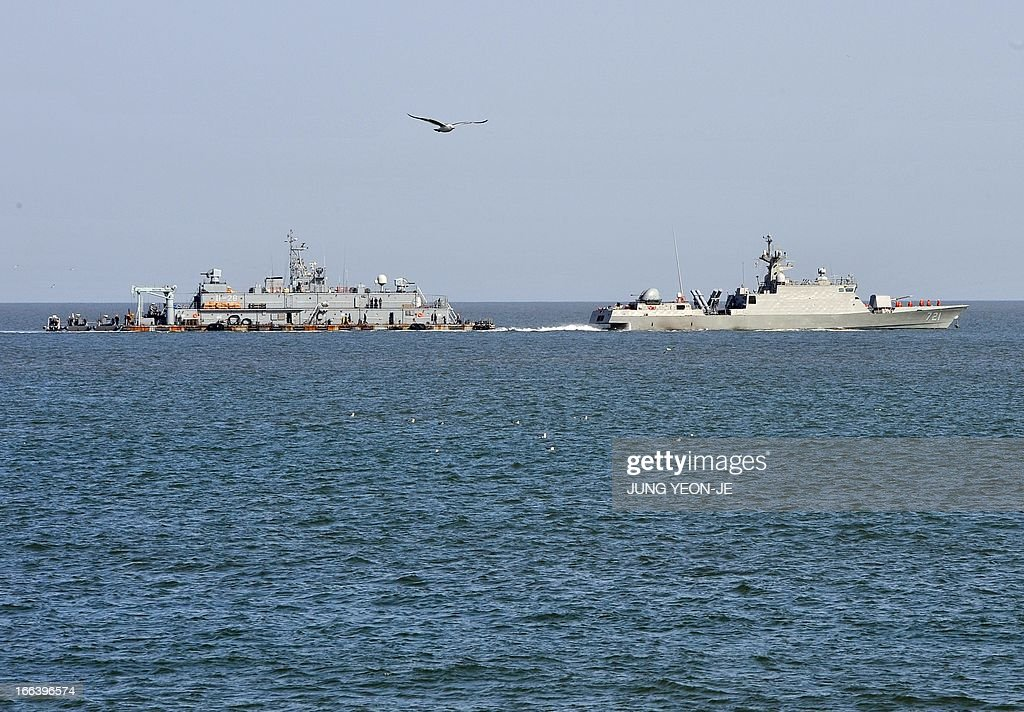 A South Korean Navy vessel sails by Navy MSB off the South Koreacontrolled island of Yeonpyeong near the disputed waters of the Yellow Sea on April...