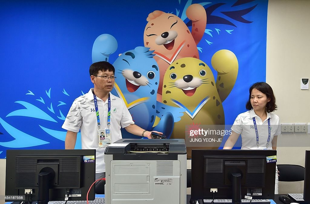 South Korean officials work at the NOC services center of the Athletes' Village for the upcoming 2014 Asian Games during a media tour in Incheon on August 26, 2014. The 2014 Asian Games will take place between September 19 and October 4, with Asia's top athletes competing across 36 sports.