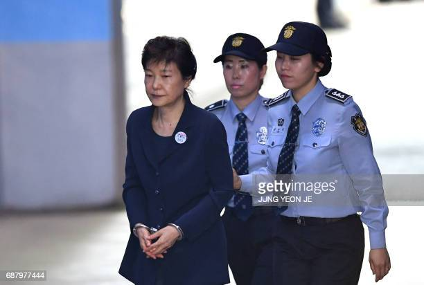 TOPSHOT South Korean ousted leader Park GeunHye arrives at the Seoul Central District Court in Seoul on May 25 2017 for her trial over the massive...