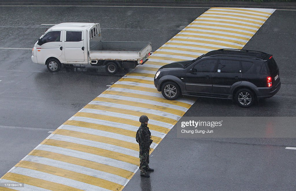 South Korean owners and workers' vehicles leave for North Korea's city Kaesong at the customs, immigration and quarantine office on July 10, 2013 in Seoul, South Korea. Government officals and business leaders from North and South Korea will hold talks today to discuss resuming operations at the Kaesong Joint Industrial Park 10 kilometres north of the border. North Korea withdrew over 50,00 of it's staff from the factories owned by Seoul in April of this year, and South Korea removed managers in May, during the height of tensions between the two nations.