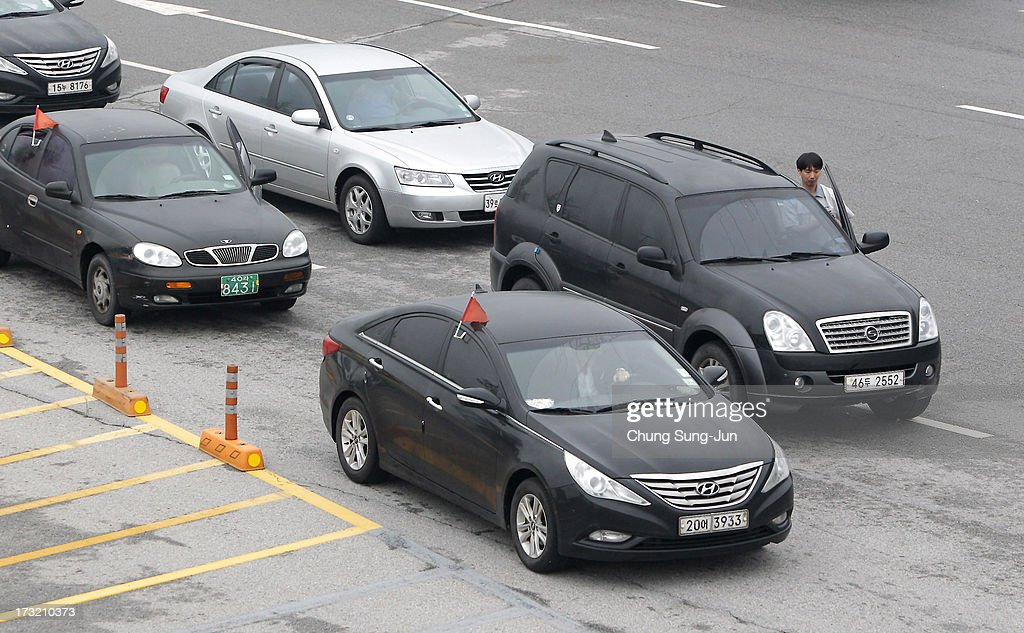 South Korean owners and workers' vehicles return back from North Korea after after visiting North Korea's city Kaesong on July 10, 2013 in Paju, South Korea. Government officials and business leaders from North and South Korea will hold talks today to discuss resuming operations at the Kaesong Joint Industrial Park 10 kilometres north of the border. North Korea withdrew over 50,00 of it's staff from the factories owned by Seoul in April of this year, and South Korea removed managers in May, during the height of tensions between the two nations.