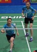 South Korean pair Jung Kyungeun and Kim Hana return to China's Yu Yang and Wang Xiaoli during their women's double quarterfinal at World Badminton...
