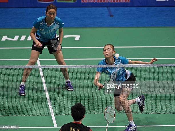 South Korean pair Jung Kyungeun and Kim Hana return to China's Yu Yang and Wang Xiaoli during their women's double quarterfinal at World Badminton...