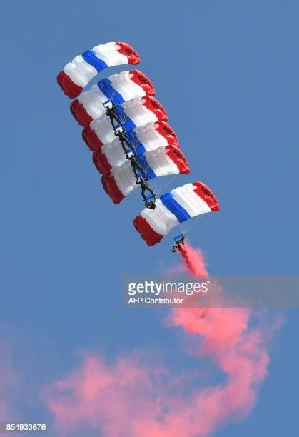 South Korean paratroopers perform a formation jump during a commemoration ceremony marking South Korea's Armed Forces Day which will fall on October...