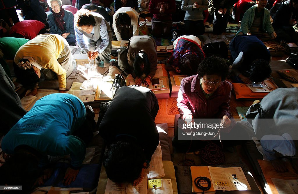 South Korean parents pray for their children's success in the annual college entrance examination, at Chogye Buddhist temple on November 13, 2008 in Seoul, South Korea. More than 580,000 high school seniors and graduates sit for the examinations at 996 test centers across the country. Success in the exam enables students to study at Korea's top universities.