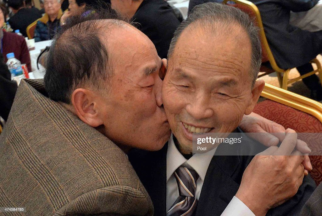 South Korean Park Se-Lim (L) meets his North Korean older brother Park Chang-Soon (R),81, during a family reunion after being separated for 60 years on February 24, 2014 in Mount Kumgang, North Korea. The program, which allows reunions of family members separated by the 1950-53 Korean war, is a result of recent agreement between Koreas which had been suspended since 2010.