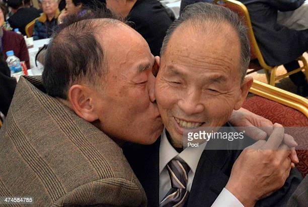 South Korean Park SeLim meets his North Korean older brother Park ChangSoon during a family reunion after being separated for 60 years on February 24...