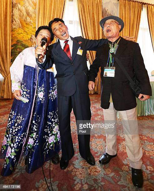 South Korean Park TaeWook sings with his North Korean cousins at the group luncheon meeting after being separated for 60 years during the family...