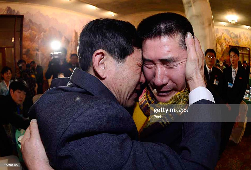 South Korean Park Yang-Gon (L) meets with his North Korean brother Park Yang-Soo during a family reunion after being separated for 60 years on February 20, 2014 in Mount Kumgang, North Korea. The program, which allows reunions of family members separated by the 1950-53 Korean war, is a result of recent agreement between Koreas which had been suspended since 2010.