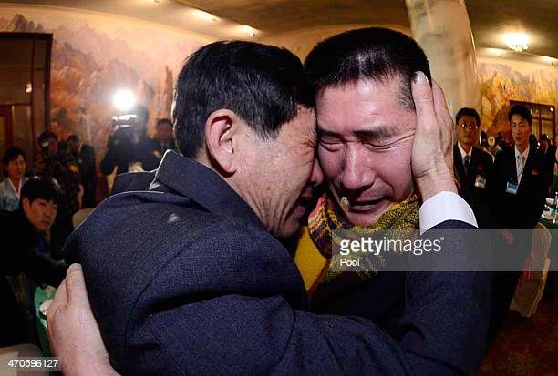South Korean Park YangGon meets with his North Korean brother Park YangSoo during a family reunion after being separated for 60 years on February 20...