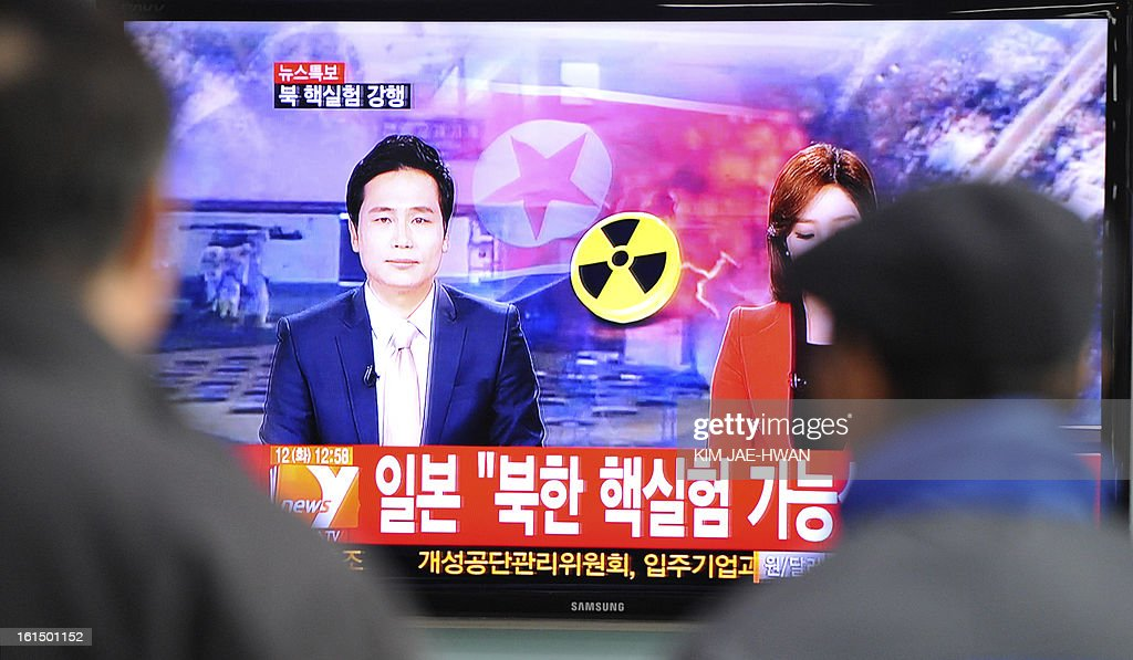 South Korean passengers watch TV news reporting North Korea's apparent nuclear test, at the Seoul train station on February 12, 2013. North Korea's apparent nuclear test had an explosive yield of between six and seven kilotons, South Korea's defence ministry said, revising its earlier estimate of 10 kilotons or more. Ministry spokesman Kim Min-Seok said seismic monitors had detected a tremor with a 4.9 magnitude emanating from the North's nuclear test site.