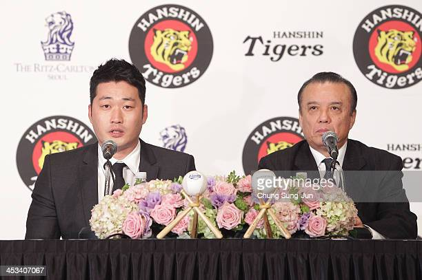 South Korean Pitcher Oh SeungHwan attends the press conference with Hanshin Tigers general manager Nakamura Katsuhiro at Ritz Carlton hotel on...