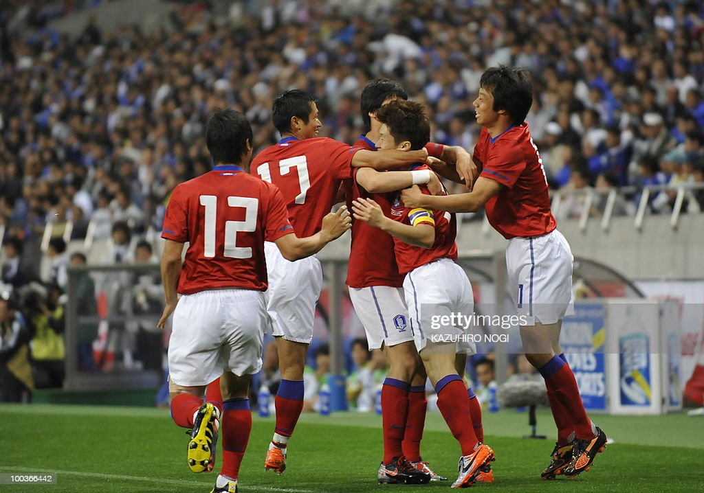 South Korean players celebrate their first goal against Japan during their international friendly football match at Saitama Stadium, suburban Tokyo, on May 24, 2010. AFP PHOTO/Kazuhiro NOGI