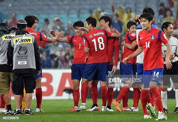 South Korean players celebrate their victory against Iraq in the semifinal football match between South Korea and Iraq at the AFC Asian Cup in Sydney...