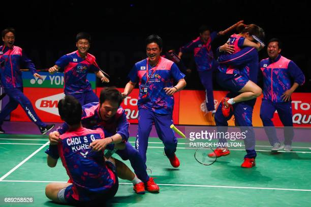 South Korean players celebrate their victory over China in the team final at the 2017 Sudirman Cup badminton tournament at the Gold Coast Sports...