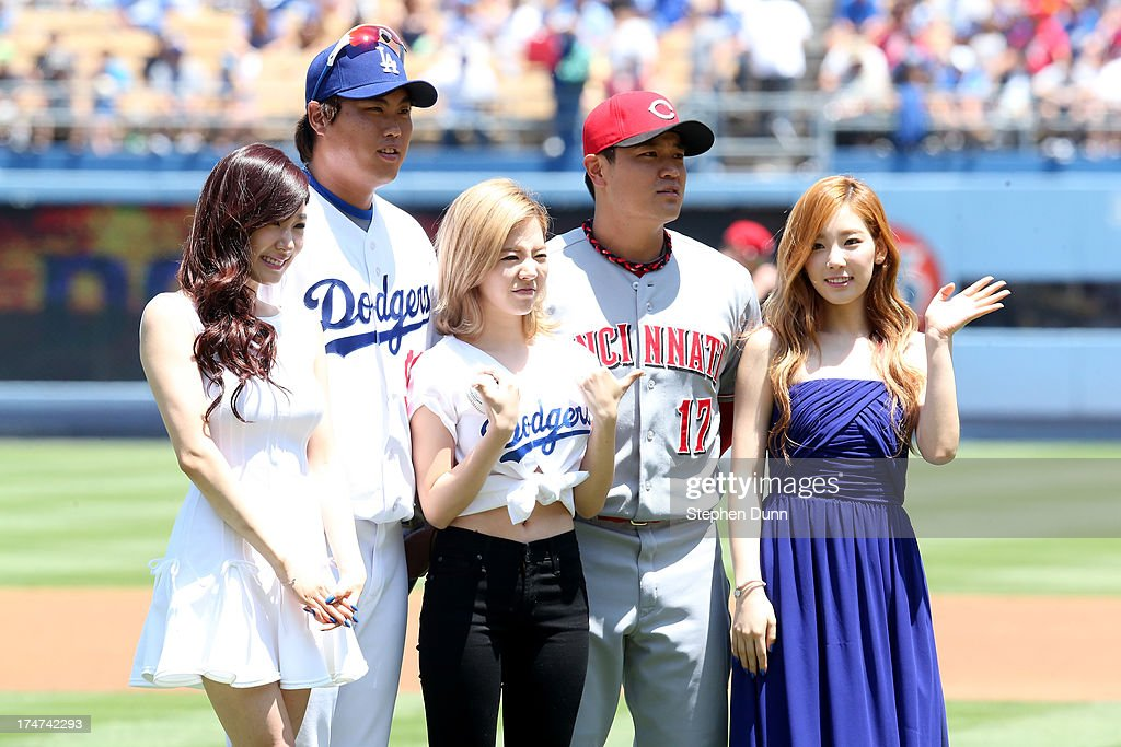 South Korean players Hyun-Jin Ryu #99 of the Los Angeles Dodgers and <a gi-track='captionPersonalityLinkClicked' href=/galleries/search?phrase=Shin-Soo+Choo&family=editorial&specificpeople=196543 ng-click='$event.stopPropagation()'>Shin-Soo Choo</a> #17 of the Cincinnati Reds pose with Korean Pop group <a gi-track='captionPersonalityLinkClicked' href=/galleries/search?phrase=Girls+Generation&family=editorial&specificpeople=7289253 ng-click='$event.stopPropagation()'>Girls Generation</a> (L to R) tiffany, Sunny, and Taeyeon during Korea Day ceremonies before the game at Dodger Stadium on July 28, 2013 in Los Angeles, California. The Dodgers won 1-0 in 11 innings.