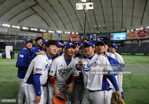 South Korean players pose for selfie photographs after their 10 victory in the Eneos Asia Professional Baseball Championship 2017 game between South...