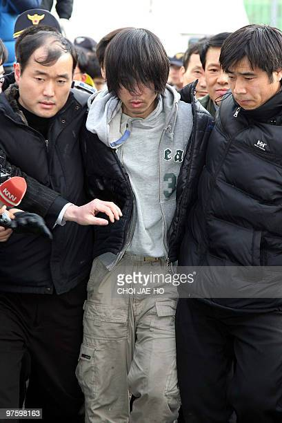 South Korean police detain Kim KilTae a suspect in the rape and murder of a 13yearold girl at a police station in the southern port city of Busan on...