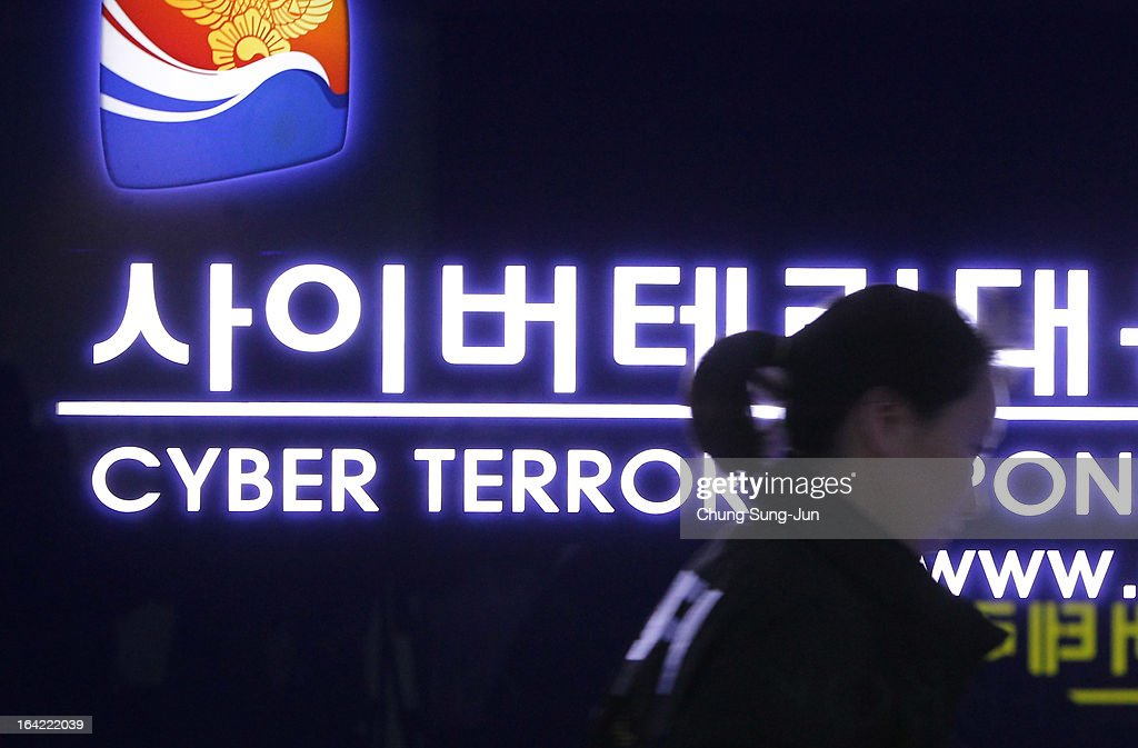 A South Korean police officer from Digital Forensic Investigation walks past at Cyber Terror Response Center at National Police Agency on March 21, 2013 in Seoul, South Korea. A cyber attack on the computer networks that run three South Korean banks, two broadcasters and an internet service provider in South Korea yesterday has been traced to an IP address in China, despite many experts suspecting the attacks to originate in North Korea. Officials noted that while the attack was traced to an IP address it China may have originated elsewhere and been routed through the country to disguise the attackers.