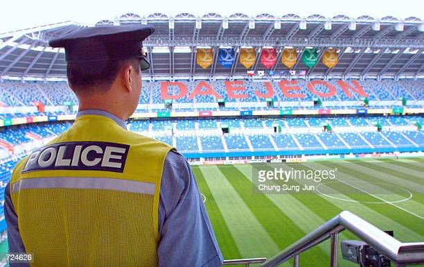 South Korean police officer scans the stadium for security before the US versus Poland game at the 2002 World Cup at Daejeon Stadium June 14 2002 in...