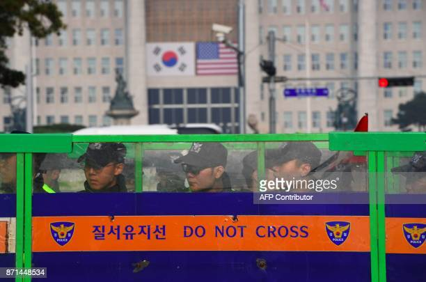 South Korean police stand guard behind a barricade near the National Assembly in Seoul on November 8 2017 as US President Donald Trump is due to...