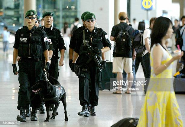 South Korean police SWAT members patrol in Incheon International Airport west of Seoul 12 July 2004 Security was tightened at South Korean airports...