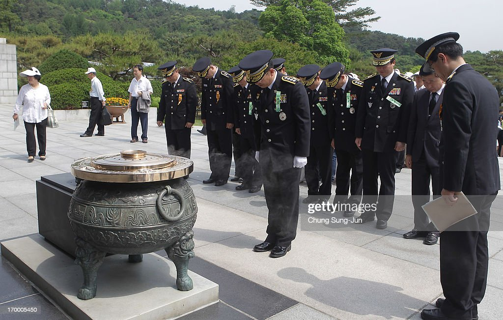 South Korean policemen bow during a ceremony marking Korean Memorial Day at the Seoul National Cemetery on June 6, 2013 in Seoul, South Korea. South Korea today marks the 58th anniversary of the Memorial Day for those killed in the 1950-53 Korean War.