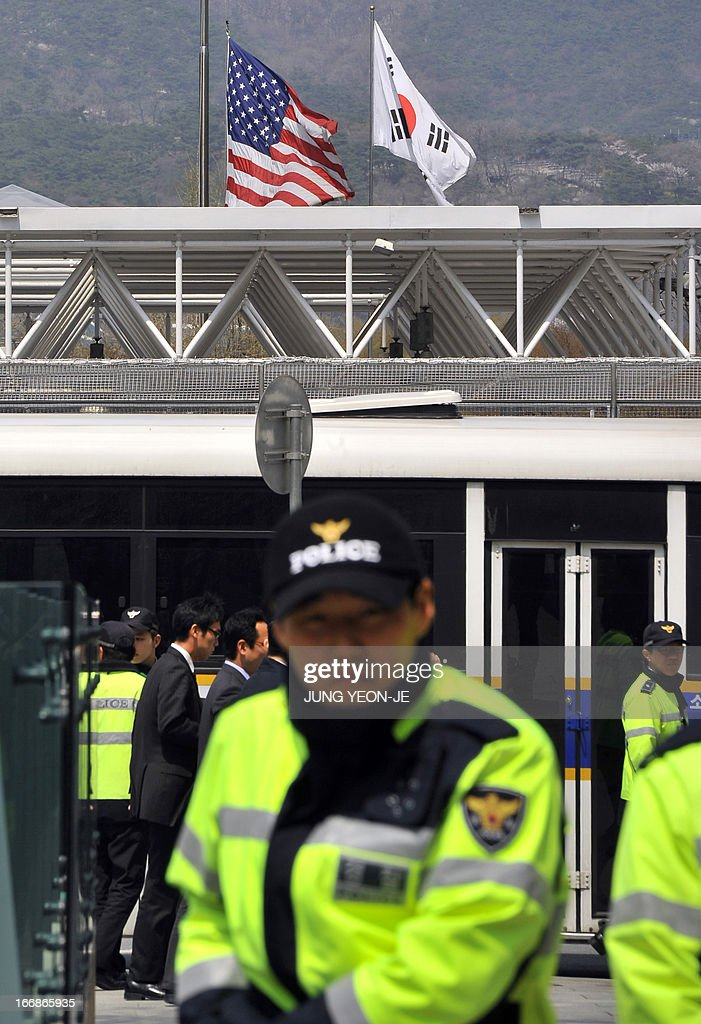 South Korean policemen gather outside the US embassy in Seoul on April 18, 2013. North Korea laid down rigid pre-conditions on April 18 for dialogue with Seoul or Washington, including the withdrawal of UN sanctions and a guaranteed end to South Korea-US joint military drills.