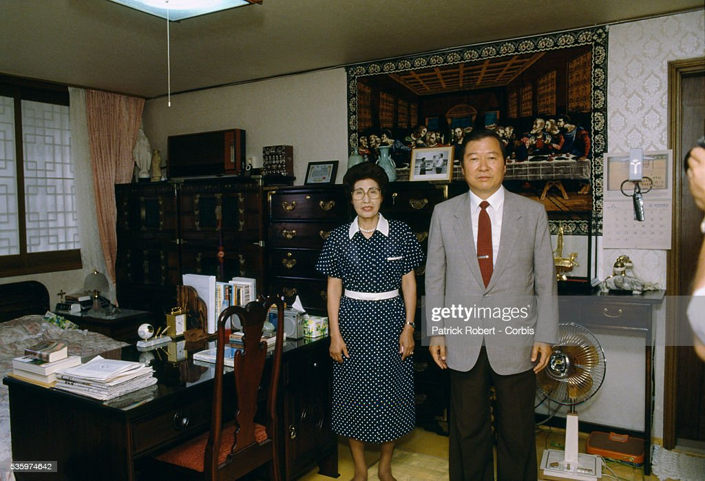 South Korean politician Kim Dae-jung poses with his wife Lee Hee-ho in Seoul. After imprisonment and exile for his pro-democracy actions, Kim returned to South Korea and ran for president in the country's first popular presidential election in 1987. He was defeated in the 1987 and 1992 elections, but won the presidency in 1997.