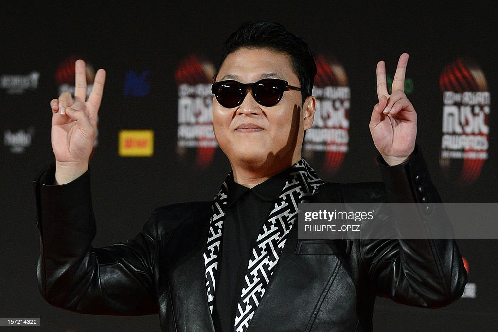 South Korean pop sensation Psy gestures on the red carpet of the 2012 Mnet Asia Music Awards in Hong Kong on November 30, 2012. Held annually with some of the most famous singers and bands taking part in the event, the Mnet Asia Music Awards is one of the biggest 'K-pop' music award ceremonies. AFP PHOTO / Philippe Lopez