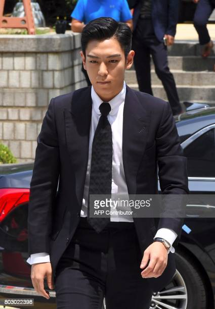 South Korean pop star TOP arrives at a court to attend his trial on charges of smoking marijuana in Seoul on June 29 2017 The rapper from Kpop boy...