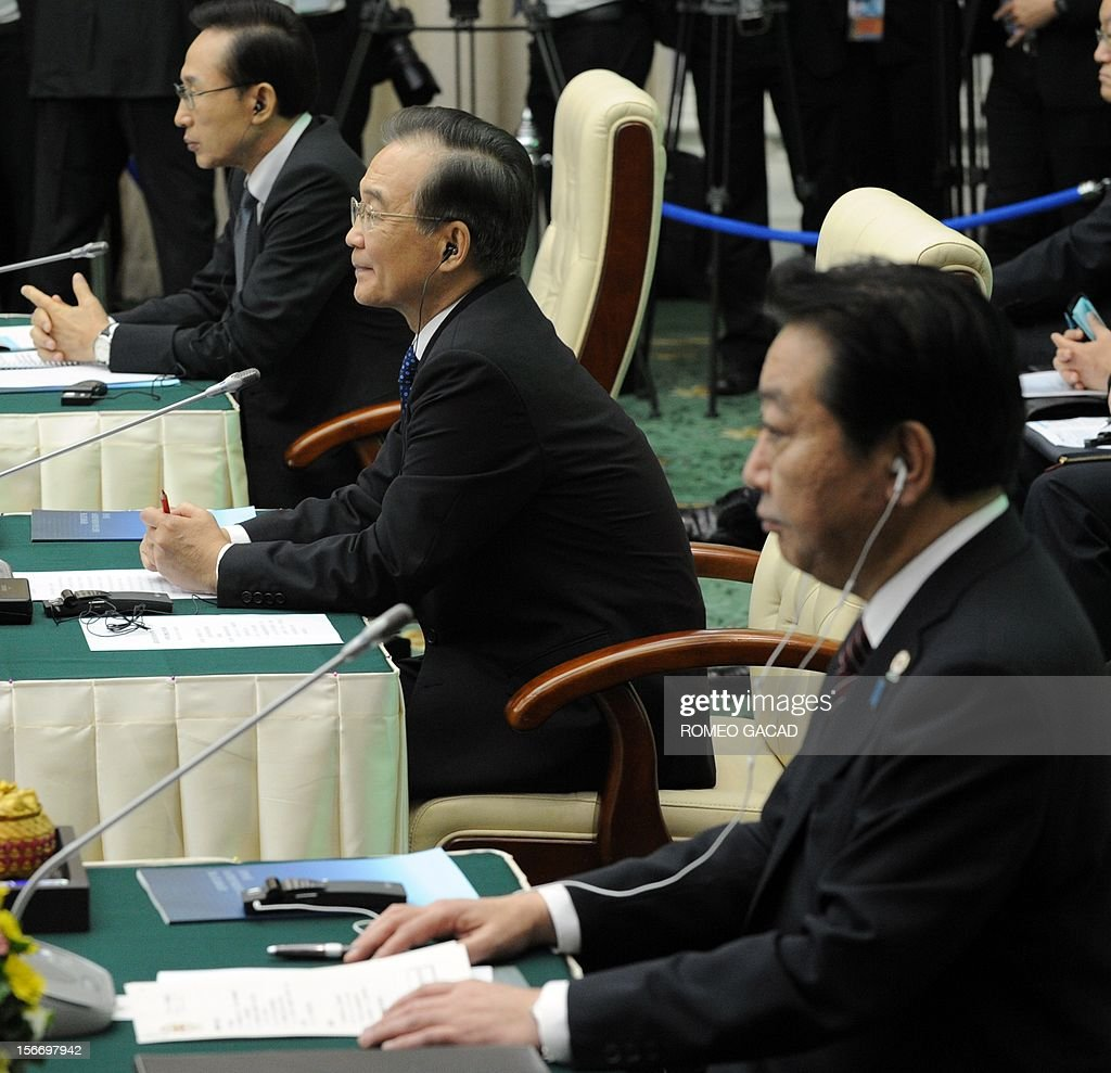 South Korean President Lee Myung Bak, (L), Chinese Premier Wen Jiabao, (C) and Japan Prime Minister Yoshihiko Noda (R) listen to the address of Cambodian Prime Minister Hun Sen during the Association of Southeast Asian Nations (ASEAN) Plus Three Commemorative Summit in Phnom Penh on November 19, 2012 following the 21st ASEAN Leaders Summit. AFP PHOTO / ROMEO GACAD