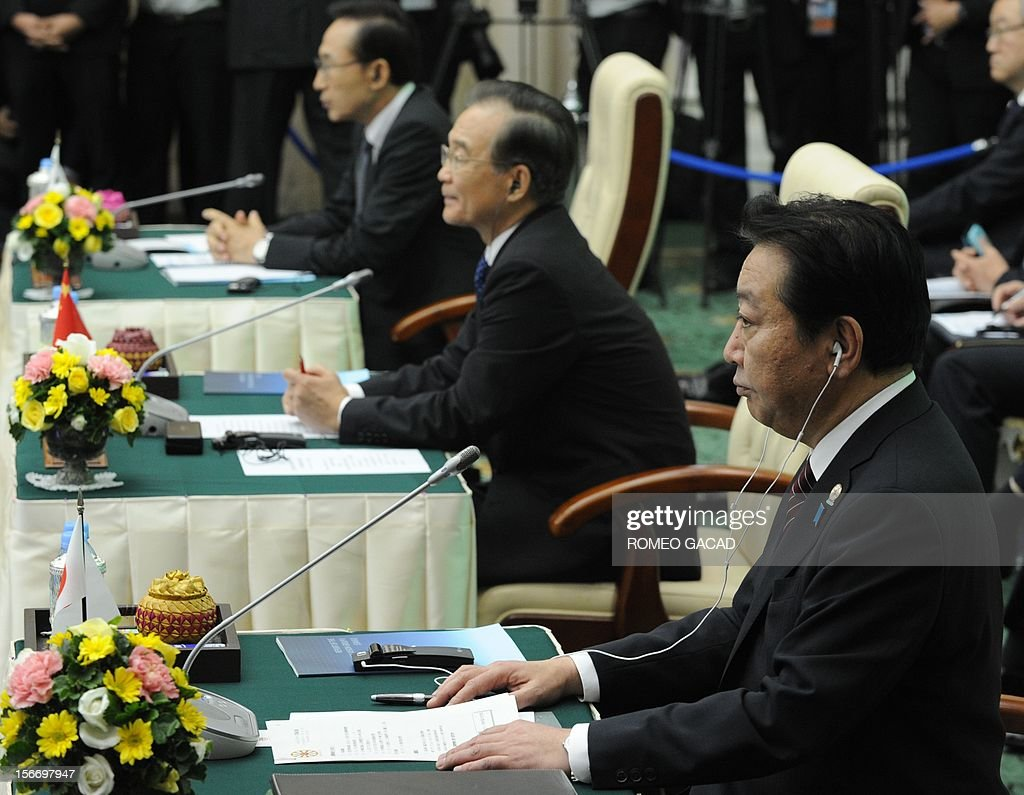 South Korean President Lee Myung Bak, (L), Chinese Premier Wen Jiabao, (C) and Japan Prime Minister Yoshihiko Noda (R) listens to the address of Cambodian Prime Minister Hun Sen during the Association of Southeast Asian Nations (ASEAN) Plus Three Commemorative Summit in Phnom Penh on November 19, 2012 following the 21st ASEAN Leaders Summit. AFP PHOTO / ROMEO GACAD