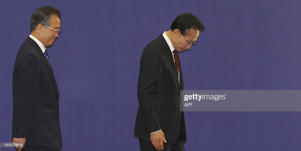 South Korean President Lee Myung-bak (R) and Chinese Premier Wen Jiabao (L) leave after a signing ceremony to set up a secretariat in South Korea in 2012 for cooperation among the three nations following trilateral summit meetings in Seogwipo on Jeju island, south of Seoul, on May 30, 2010. China came under intensified pressure from South Korea and Japan to join global efforts to punish North Korea over the sinking of a South Korean warship in March.