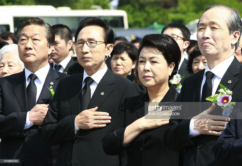 South Korean President Lee Myung-bak (2L) and his wife Kim Yoon-ok (2R) pay their respects during a ceremony for Memorial Day at the national cemetery in Seoul on June 6, 2010. The United States and its Asian allies demanded North Korea pay a price for the alleged sinking of a South Korean warship, even as Washington acknowledged diplomacy may have no effect on the reclusive regime.