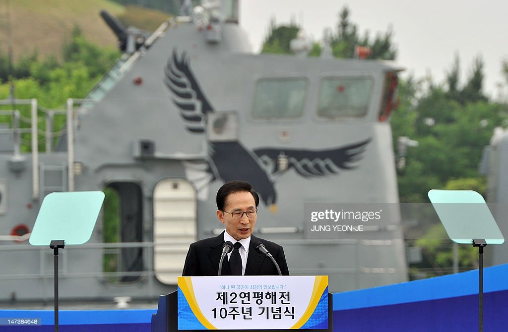 South Korean President Lee Myung-Bak delivers a speech during the 10th anniversary commemorative ceremony of the second naval battle of Yeonpyeong at the Navy's 2nd Fleet Command in Pyeongtaek, about 70 kilometers south of Seoul, on June 29, 2012. The battle erupted on June 29, 2002, when two of the North's patrol boats crossed the disputed Yellow Sea border. Six South Korean sailors were killed and 18 injured while an estimated 13 North Koreans died.