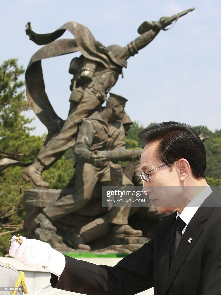 South Korean President Lee Myung-bak holds up incense as he pays his respects during a ceremony for Memorial Day at the national cemetery in Seoul on June 6, 2010. The United States and its Asian allies demanded North Korea pay a price for the alleged sinking of a South Korean warship, even as Washington acknowledged diplomacy may have no effect on the reclusive regime.