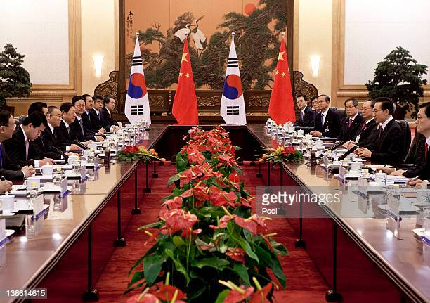 South Korean President Lee Myungbak second from right and his Chinese counterpart Hu Jintao attend a bilateral meeting at the Great Hall of the...