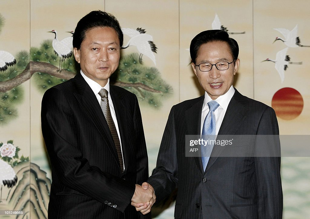 South Korean President Lee Myung-Bak (R) shakes hands with Japanese Prime Minister Yukio Hatoyama during their meeting in Seogwipo City on Jeju Island on May 29, 2010 as the latter visits for a two-day summit over global efforts to punish North Korea for the sinking of a South Korean warship in March.