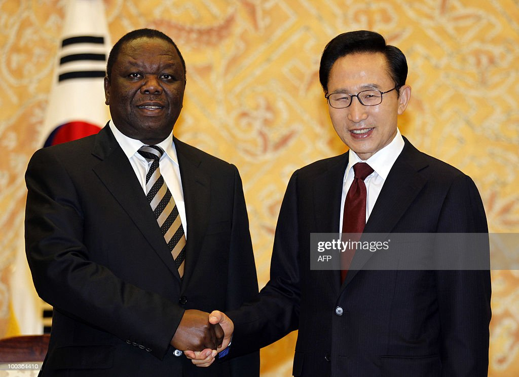 South Korean President Lee Myung-bak (R) shakes hands with Zimbabwe�s Prime Minister Morgan Tsvangirai (L) for photographs before their meeting at the presidential Blue House in Seoul on May 24, 2010. Tsvangirai arrived in Seoul on May 23 for a four-day visit.