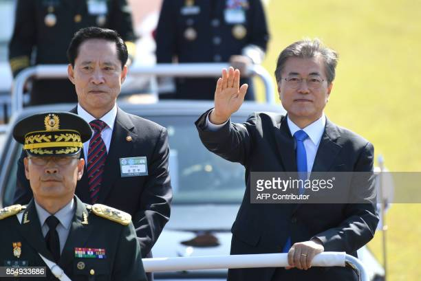 South Korean President Moon JaeIn and Defence Minister Song YoungMoo review the troops during a commemoration ceremony marking South Korea's Armed...