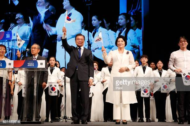 South Korean President Moon Jaein and his wife Kiim JungSook wave hational flags during the celebration of 72nd anniversary of the Liberation Day on...