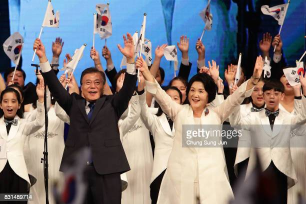South Korean President Moon Jaein and his wife Kim JungSook wave national flags during the celebration of 72nd anniversary of the Liberation Day on...