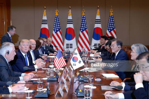 South Korean President Moon JaeIn talks with US President Donald Trump during their summit at the presidential Blue House on November 7 2017 in Seoul...
