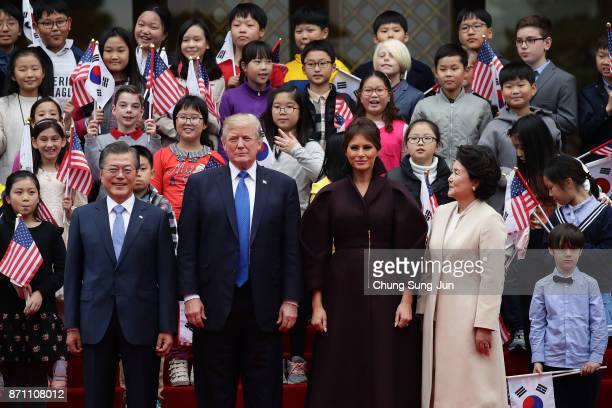 South Korean President Moon JaeIn US President Donald Trump US First Lady Melania Trump and South Korean first lady Kim JungSook attend the welcoming...