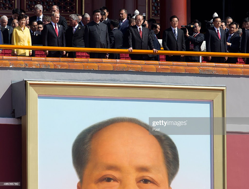 South Korean President Park Geun Hye, Russian President Vladimir Putin, Chinese President Xi Jinping, former Chinese President Jian Zemin, former Chinese President Hu Jintao, and Chinese Premier Li Keqiang arrive on top of Tiananmen Gate to watch a military parade to commemorate the 70th anniversary of the end of World War II on September 3, 2015 in Beijing, China. China is marking the 70th anniversary of the end of World War II and its role in defeating Japan with a new national holiday and a military parade in Beijing.