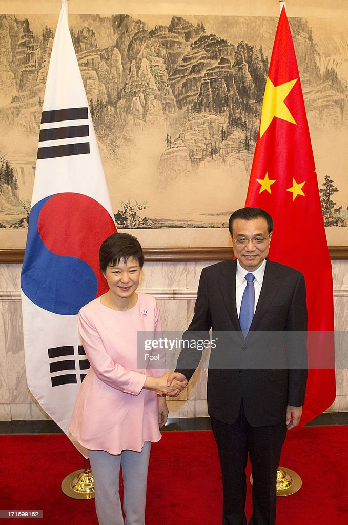 South Korean President Park Geun-Hye (L) and Chinese Premier <a gi-track='captionPersonalityLinkClicked' href=/galleries/search?phrase=Li+Keqiang&family=editorial&specificpeople=2481781 ng-click='$event.stopPropagation()'>Li Keqiang</a> (R) meet at the Diaoyutai State Guesthouse on June 28, 2013 in Beijing, China. South Korean President Park Geun-Hye is on a four-day visit to China.
