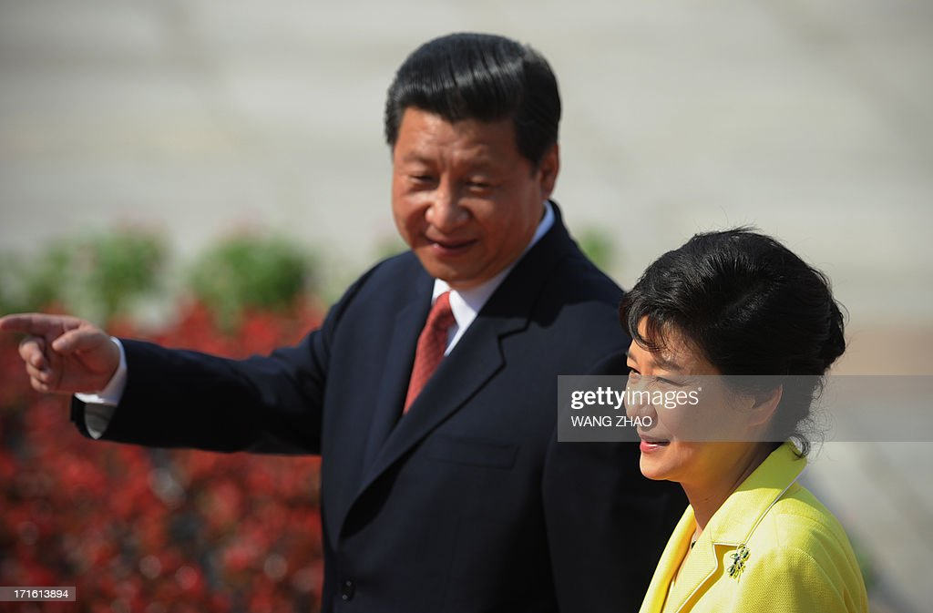 South Korean President Park Geun-Hye (R) and Chinese President Xi Jinping (L) inspect Chinese honour guards during a welcoming ceremony outside the Great Hall of the People in Beijing on June 27, 2013. Park Geun-Hye is on a visit to China from June 27 to 30.
