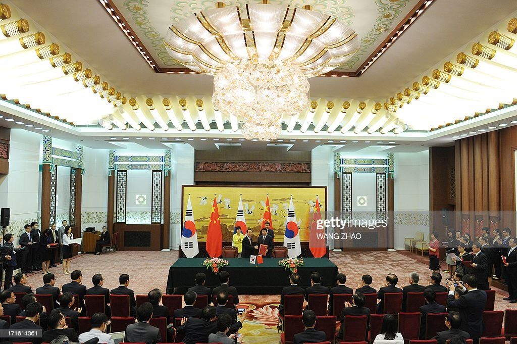 South Korean President Park Geun-Hye (L) and Chinese President Xi Jinping (R) attend a signing ceremony at the Great Hall of the People in Beijing on June 27, 2013. Park Geun-Hye is on a visit to China from June 27 to 30.